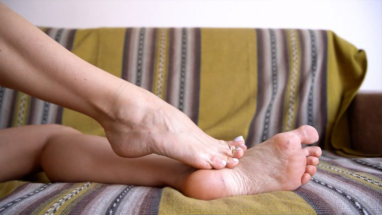 Barefoot girl shows her soles